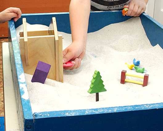 play enactment with sandpit